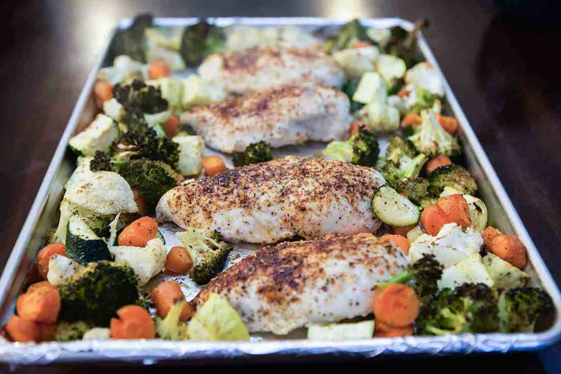 oven roasted chicken and veggies on pan