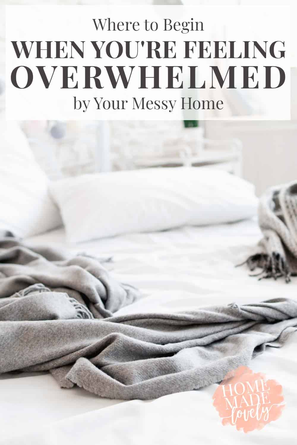 messy bed with white and grey blankets