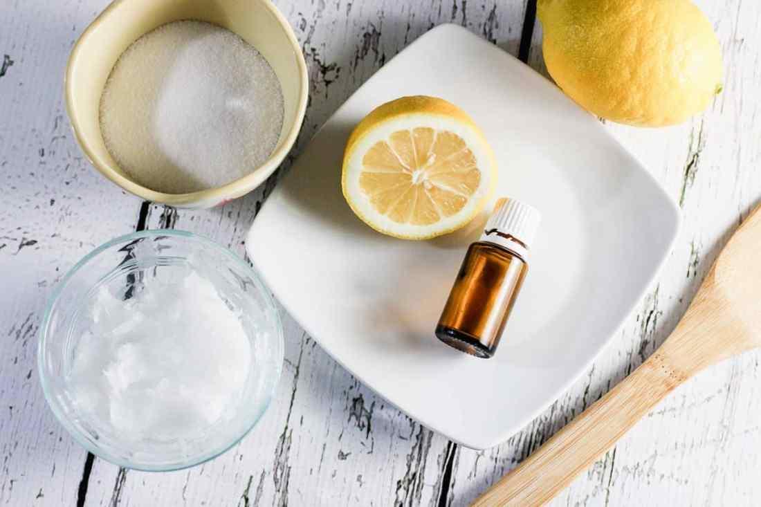 sugar, lemon, bowl, essential oils ready to make homemade sugar scrub