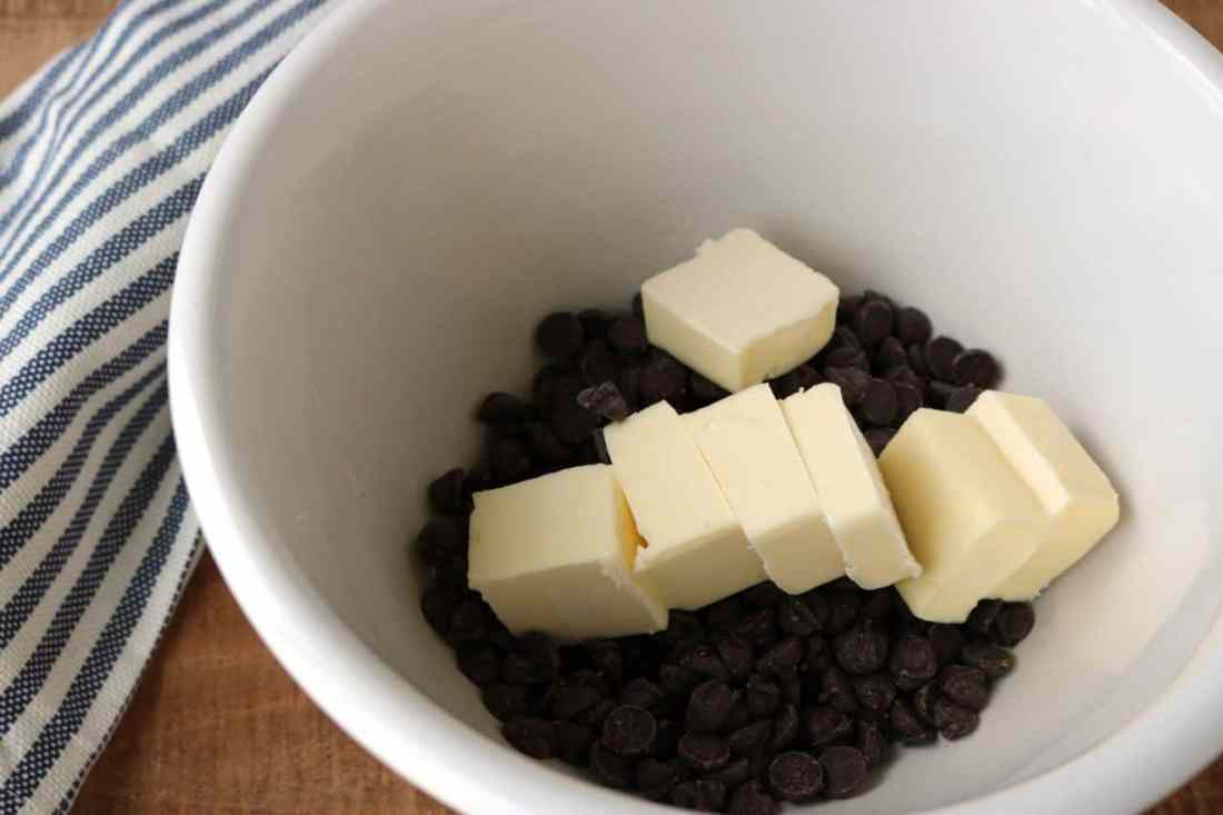 chocolate chips and butter in mixing bowl for melting