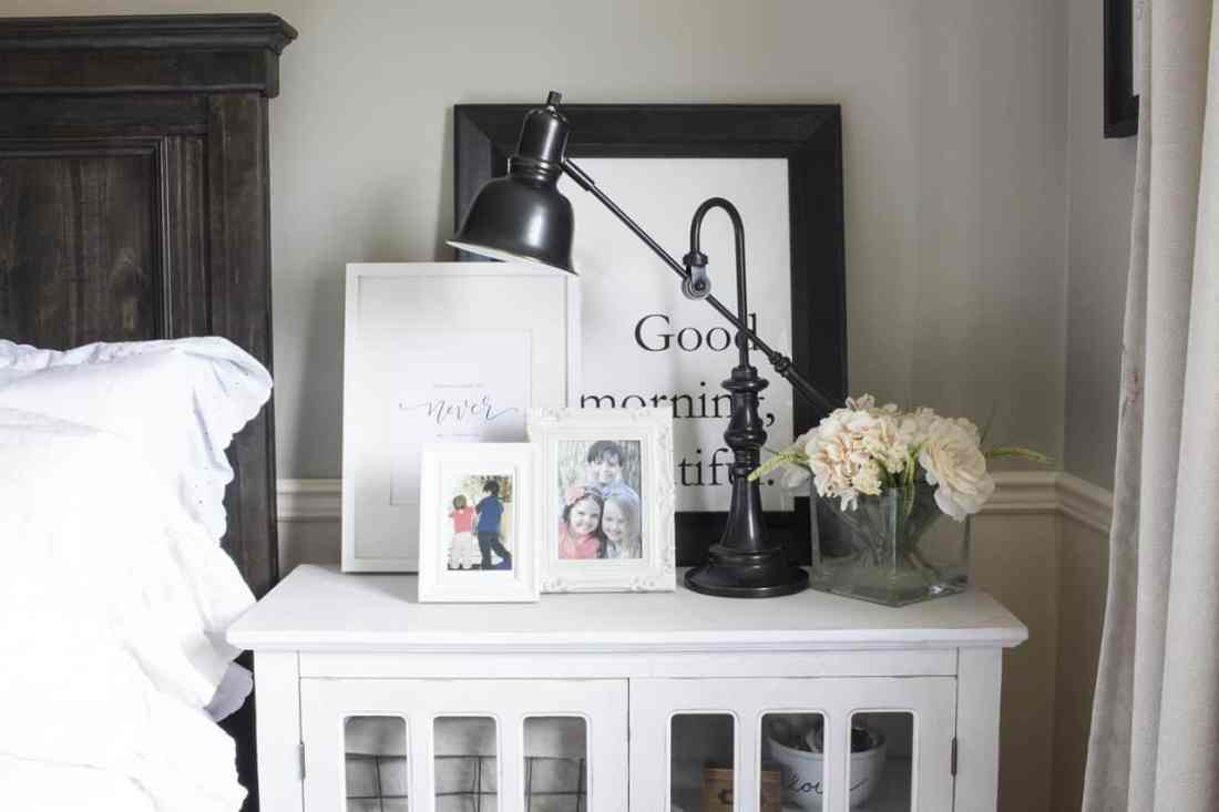 family photos and frames on nightstand