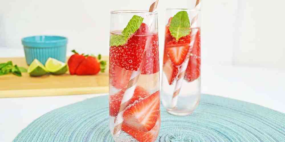 strawberry smash cocktail in two tall glasses