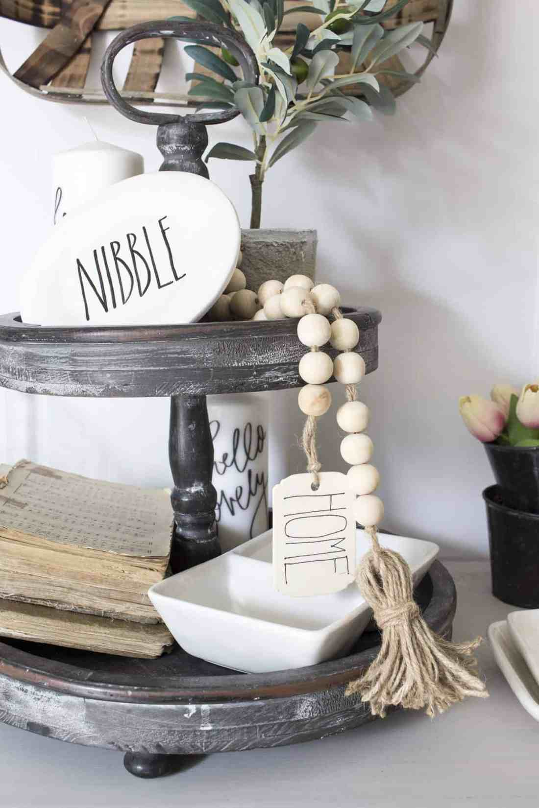 Make your own DIY wood bead garland with tassles and tag for your boho or farmhouse decorated home! The project only takes about 15 minutes!