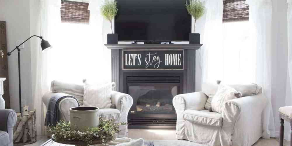 farmhouse grey fireplace and two chairs