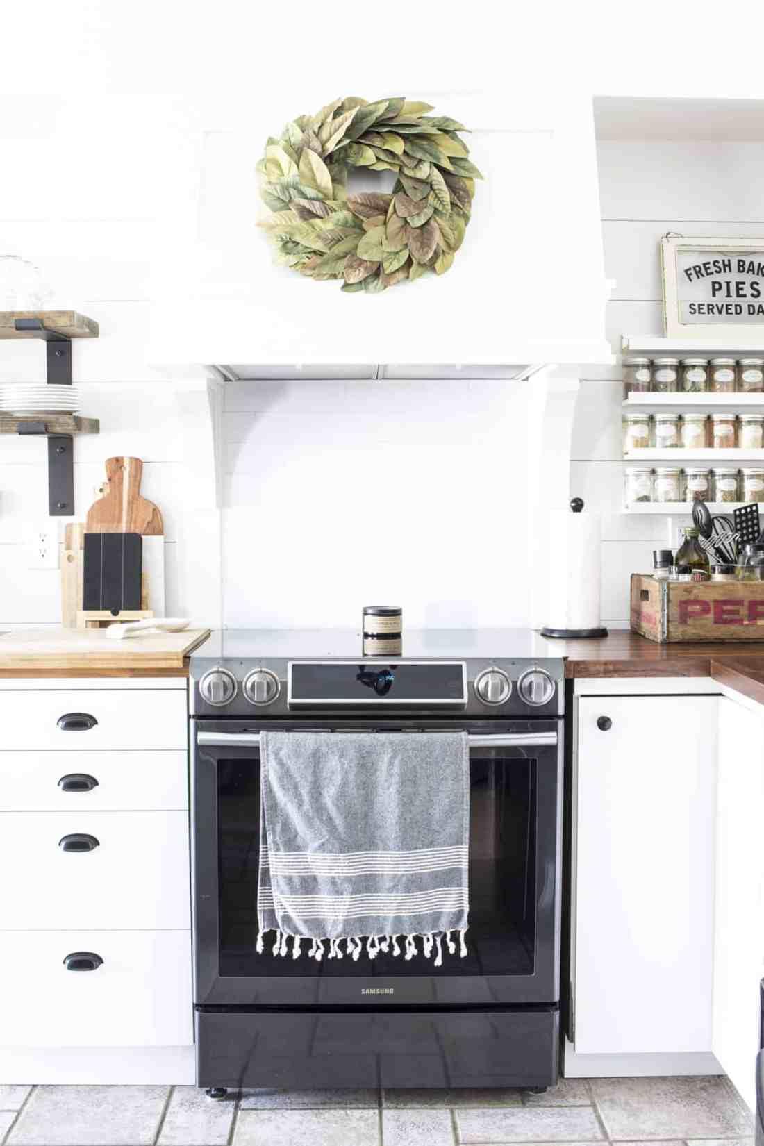 farmhouse kitchen magnolia wreath on range hood
