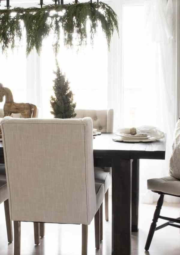Modern Farmhouse Dining Room Filled with Cozy Christmas Decor