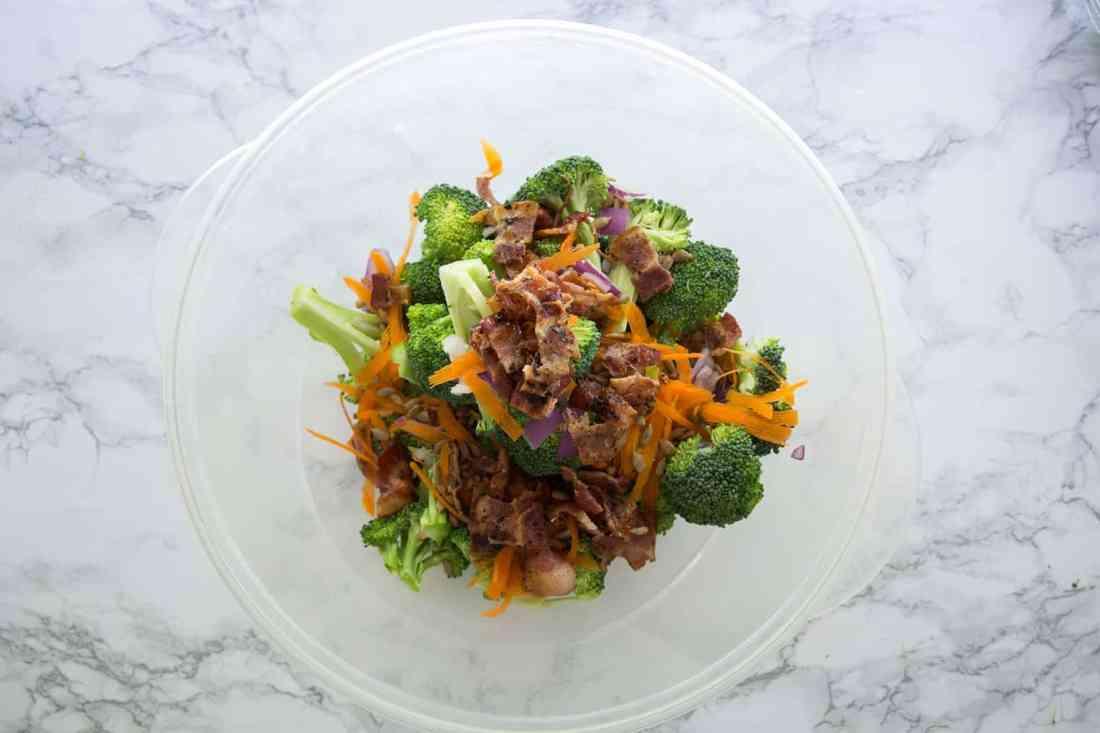 mixing salad ingredients