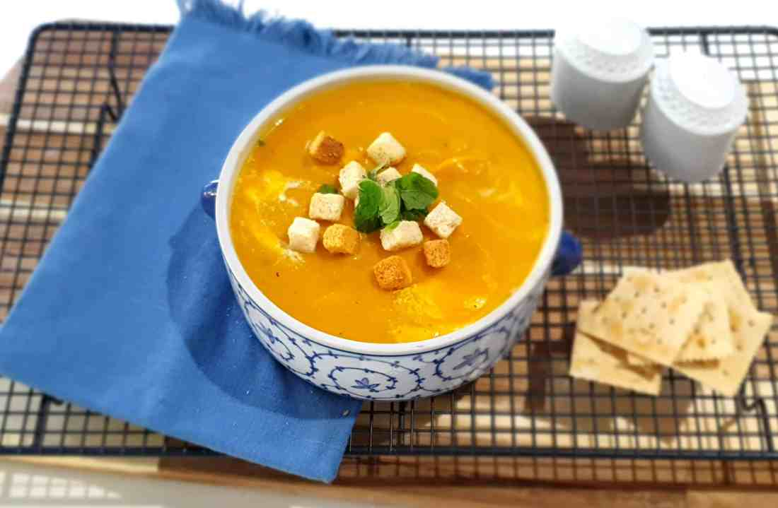 roasted pumpkin and garlic soup in bowl with croutons