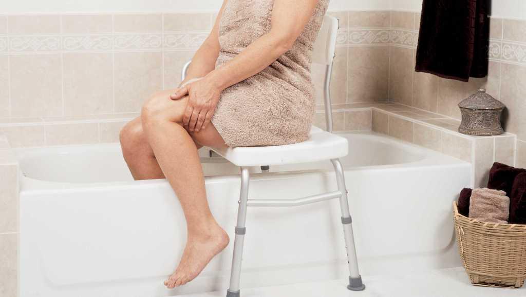 lady stepping into bath, bath bench