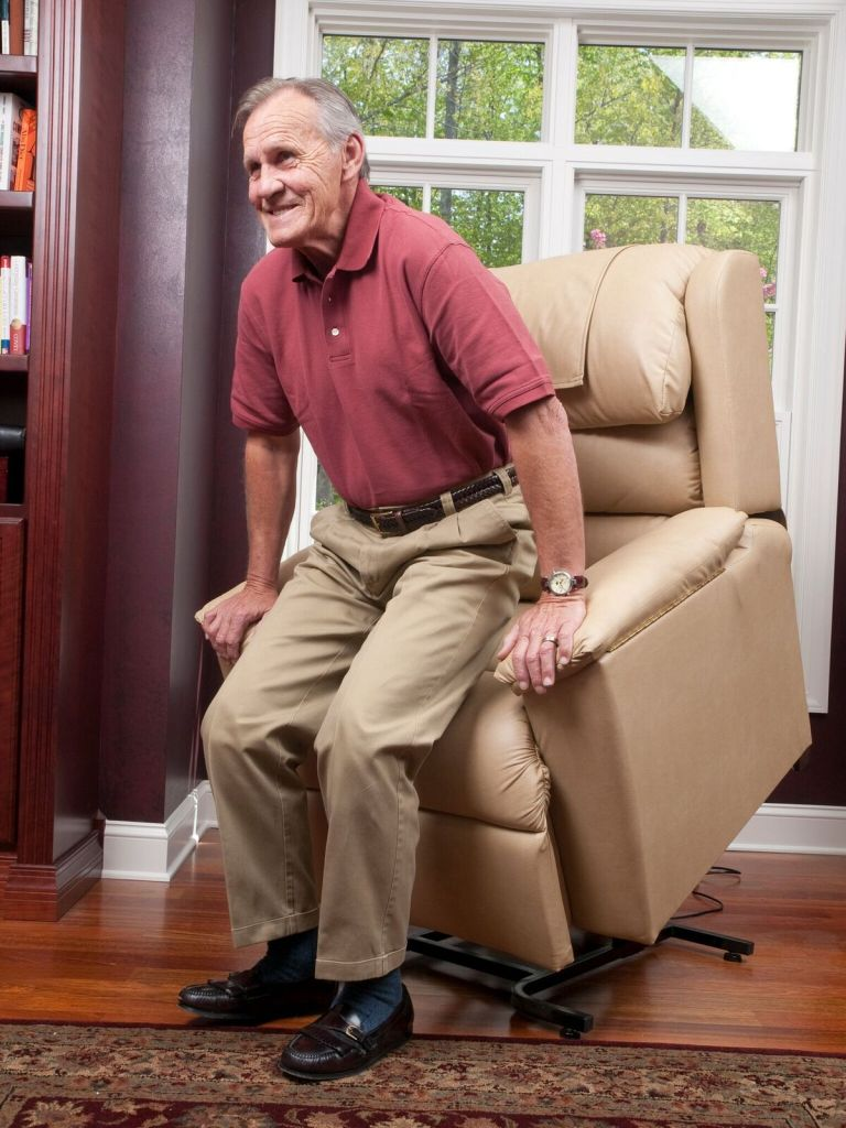 man red shirt standing up-lift chair