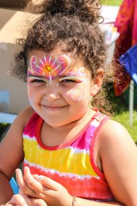 Smiling little girl with facepaint design