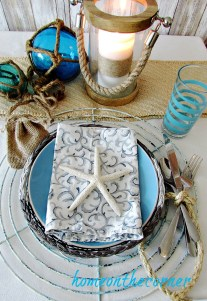 tablescapes 2017 nautical starfish, candle lantern, glass floats