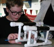 A middle schooler tweaks his underwater vehicle in the minutes before the start of Tuesday's West Hills STEM Academy SeaPerch pool challenge. More than 90 middle school students from area schools converged on the Olympic High School pool Tuesday to take part in the event. Volunteers from the Shipyard helped the students prepare in the weeks leading up to the event and were on hand Tuesday to mentor and assist participants. (March 29 2016)