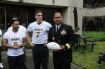 admiral-mayes-accepts-game-ball-from-the-2016-navy-flag-football-team