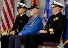 EVERETT, Wash. (Dec. 7, 2016) Raymond Wans, Pearl Harbor survivor, sits beside Lt. j.g. Richard Min, Naval Station Everett (NSE) chaplain, and Capt. Mark Lakamp, NSE commanding officer during the Pearl Harbor 75th Commemoration and World War II Remembrance Ceremony in NSE Grand Vista Ballroom. Service members, veterans and civilians came together at NSE to honor the men and women who fought and died in Pearl Harbor and World War II. (U.S. Navy photo by Petty Officer 3rd Class Joseph Montemarano/Released)