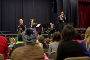 161214-N-ZP059-075 SILVERDALE Wash., (Dec. 14, 2016) Petty Officer 3rd Class Daniel Arute, a member of Navy Band Northwest's Brass Quintet, talks to parents, students and staff of Central Kitsap Middle School during a holiday concert. This was the first time that the Brass Quintet has played at Central Kitsap Middle School. (U.S. Navy photo by Petty Officer 2nd Class Jacob G. Sisco/Released)