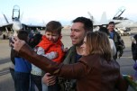 161230-N-DC740-047 OAK HARBOR, Wash. (Dec. 30, 2016) Lt. Cmdr. Kevin Jones, Electronic Attack Squadron 130, poses with his wife and son after returning home from deployment at Naval Air Station Whidbey Island. Electronic Attack Squadron 130 conducted electronic warfare operations in the 5th Fleet area of responsibility while embarked on USS Dwight D. Eisenhower (CVN 69). (U.S. Navy photo by Mass Communication Specialist 2nd Class John Hetherington/Released)