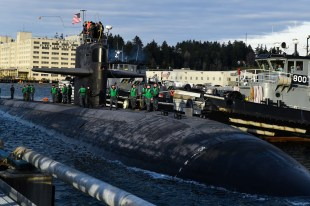 170127-N-SH284-138 BREMERTON, Wash. (Jan. 27, 2017) Crew members of the Los Angeles-class fast-attack submarine USS Olympia (SSN 717) toss the mooring lines across at it arrives at Naval Base Kitsap-Bremerton, visiting the Pacific Northwest for the first time since 1998. During their stay, crew members will tour their namesake, Olympia, Washington, where they will help the community through conducting COMRELs, and take a tour the capitol and the Olympia Yacht club. (U.S. Navy photo by Mass Communication Specialist 2nd Class Vaughan Dill/Released)