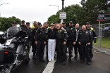 170610-N- HM829-001 PORTLAND, Ore. (June 10, 2017) Vice Adm. Nora Tyson, commander of U.S. 3rd Fleet, poses for a photo with Portland law enforcement official police escorts for the Grand Floral Parade during Portland Rose Festival Fleet Week 2017. The festival and Portland Fleet Week are a celebration of the sea services with Sailors, Marines, and Coast Guard members from the U.S. and Canada making the city a port of call. (U.S. Navy photo by Mass Communication Specialist 2nd Class K. Cecelia Engrums/Released)