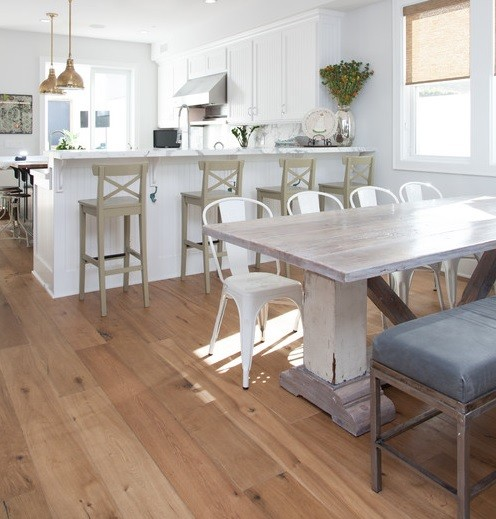 Distressed wood dining table with white chairs  Home