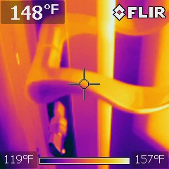 Careful, grabbing this storm door handle may burn you