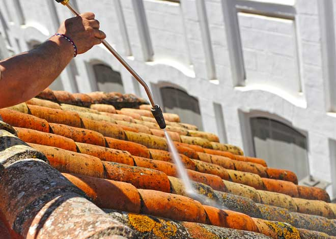 Old Roof Being Pressure Washed
