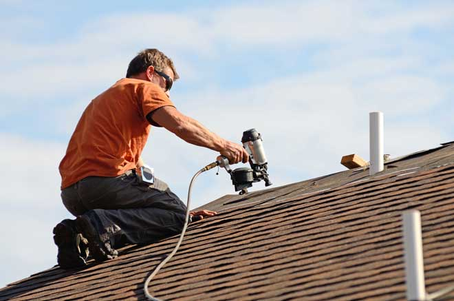 Roofing Contractor Using Nail Gun