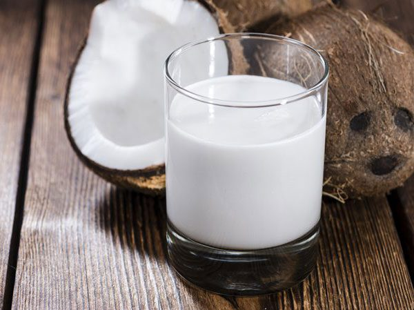 Coconut milk for frizzy hair on top of head curly hair