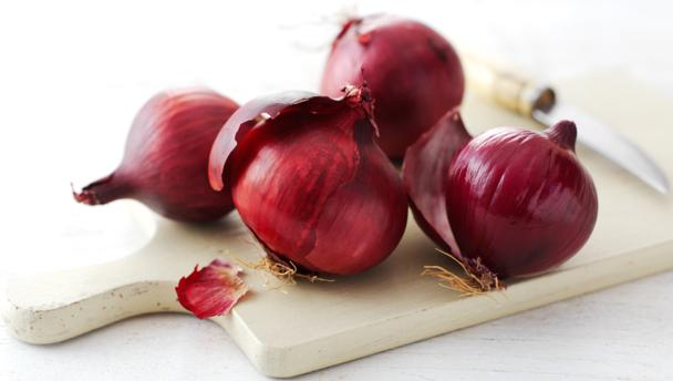 red onions on a cutting board