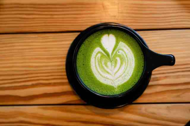 matcha milk tea pictured makes our list of the 32 foods that burn belly fat fast