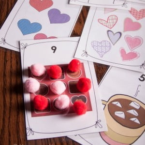 Practice one-to-one correspondence with Valentine's Day themed mats.