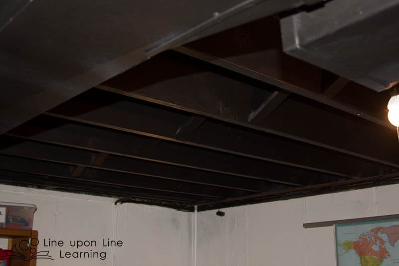 Painting the unfinished ceiling black helps make the space look more finished. The ceiling seems to melt away.