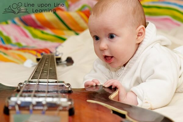 Infant play ideas: introduce music and use musical voices with your baby.