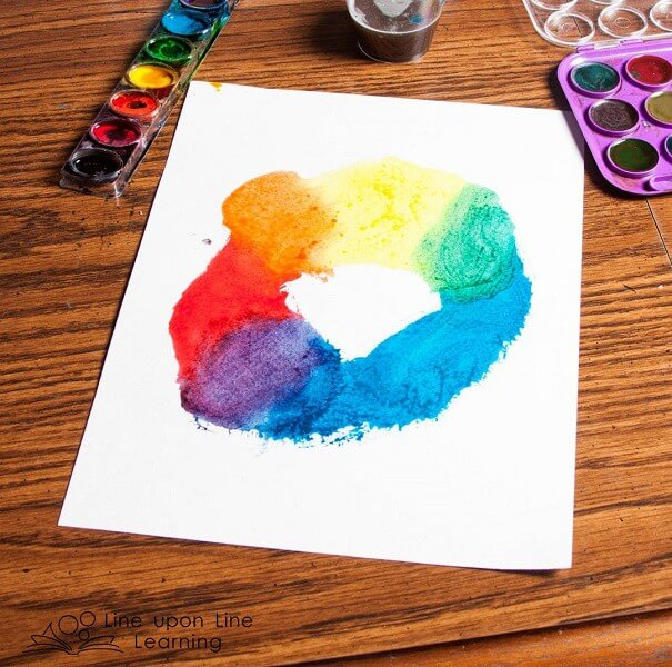 """We created """"all the colors in the world"""" like the color kittens, starting with red, yellow, and blue. Strawberry loved seeing the new colors come together as we blended the paints."""