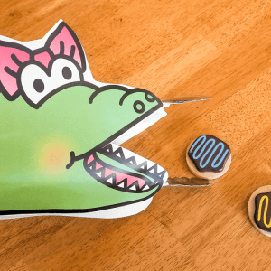 A is for Alligator. Use tongs or tweezers as the alligator's mouths and feed them!