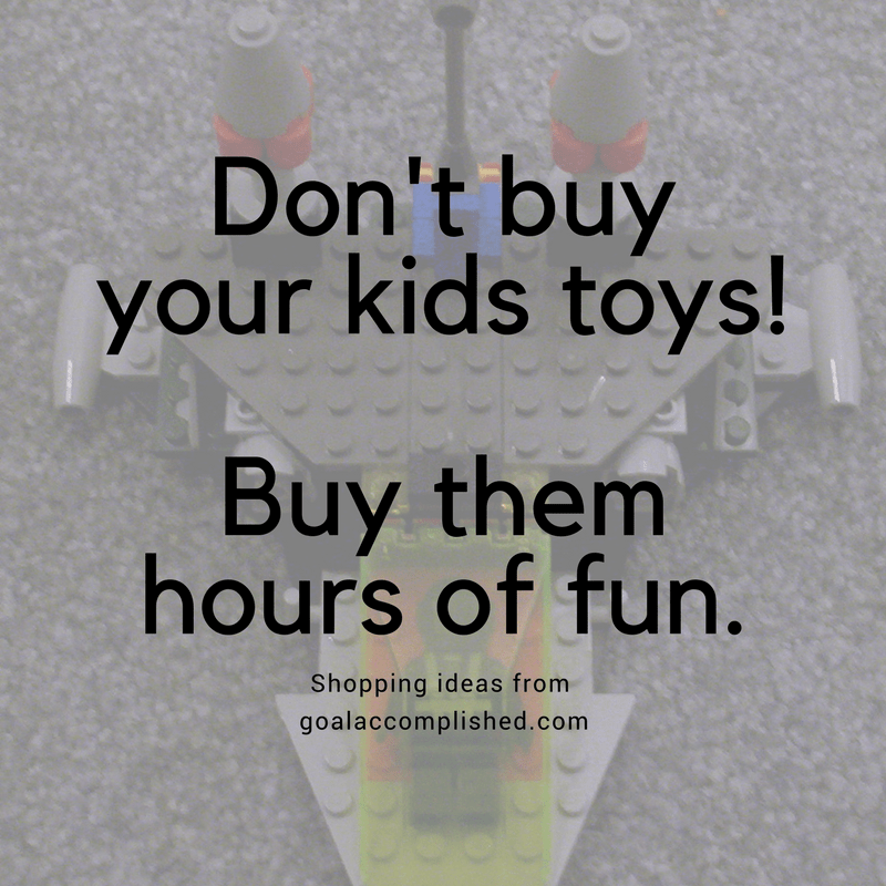 Picture of Lego creation for Christmas gift giving. Text says: Don't buy your kids toys! Buy them hours of fun. Ideas from Goal Accomplished.com