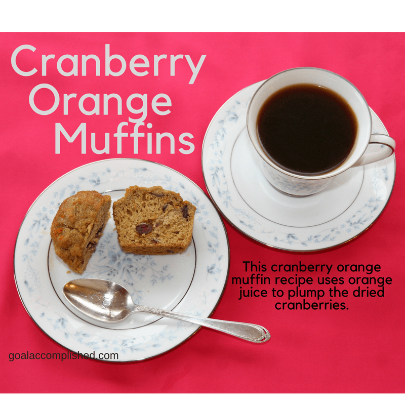 Muffin on china plate with coffee in china teacup, design Carolyn. Text: This cranberry orange muffin has a nice flavor zing because the dried cranberries are plumped with orange juice.