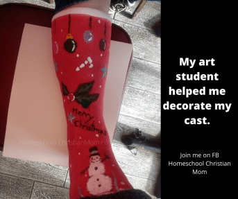 Showing my broken foot in a red cast, decorated for Christmas by my art student.