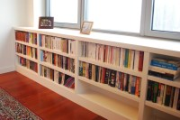 Under Window Bookcase Offers Extra Book Storage