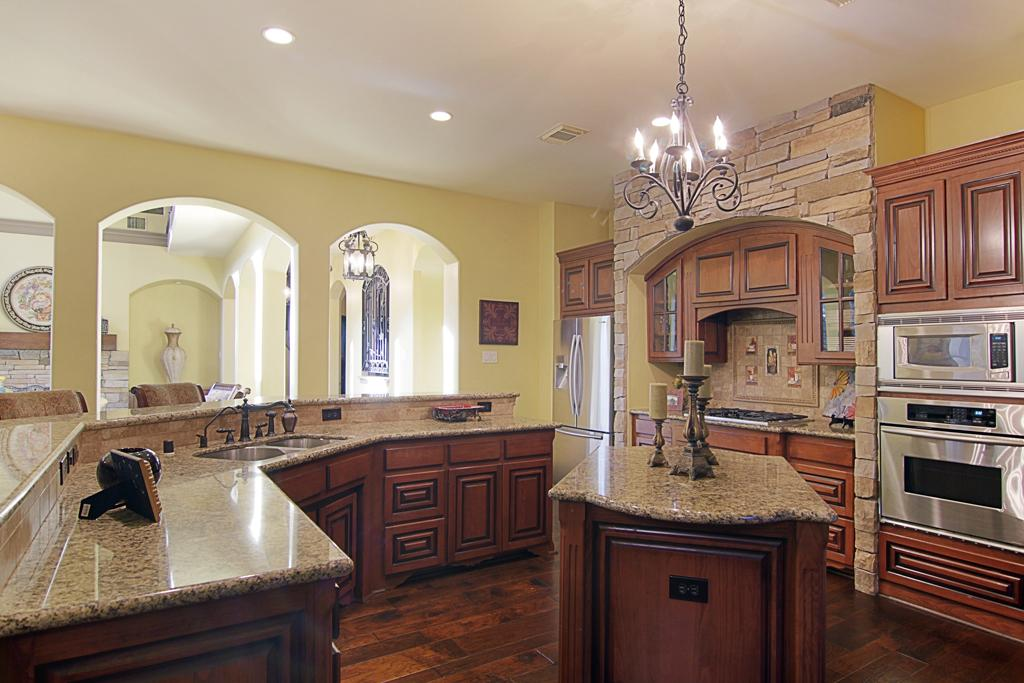 bronze kitchen appliances axor faucet oil rubbed with stainless steel glossy in the brown marble countertop and island clic pendant