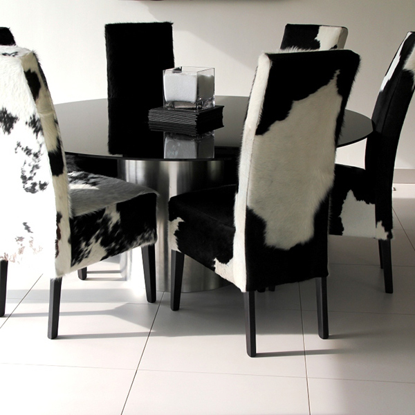 black and white cowhide chair eno lounger dining chairs fun stylish choice of furniture for room round glass table ceramic tiles floors