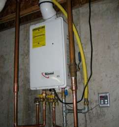 rinnai modern tankless water heater installation indoor on wall plus metal pipes and remote control [ 768 x 1024 Pixel ]