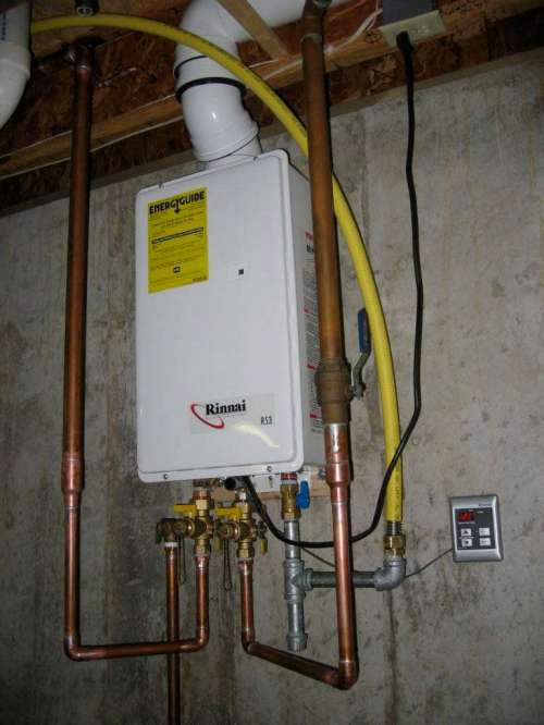 small resolution of rinnai modern tankless water heater installation indoor on wall plus metal pipes and remote control