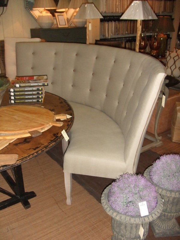 Round Dining Table with Curved Banquette Seating