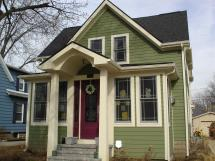 Cream House with Green Siding and Trim