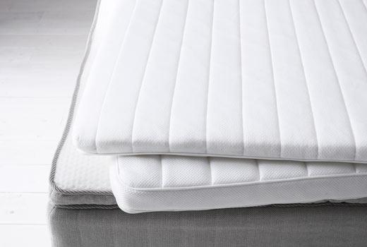 Three Pieces Of White Ikea Mattress Pads