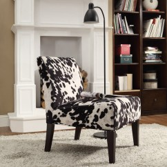 Cowhide Print Accent Chair Cane Seat Chairs Antique Have A Cow For Interior With Sweet Milky Nuance Homesfeed Posh Armless Design Beneath Curve Black Floor Lamp On Furry Rug Aside Wooen