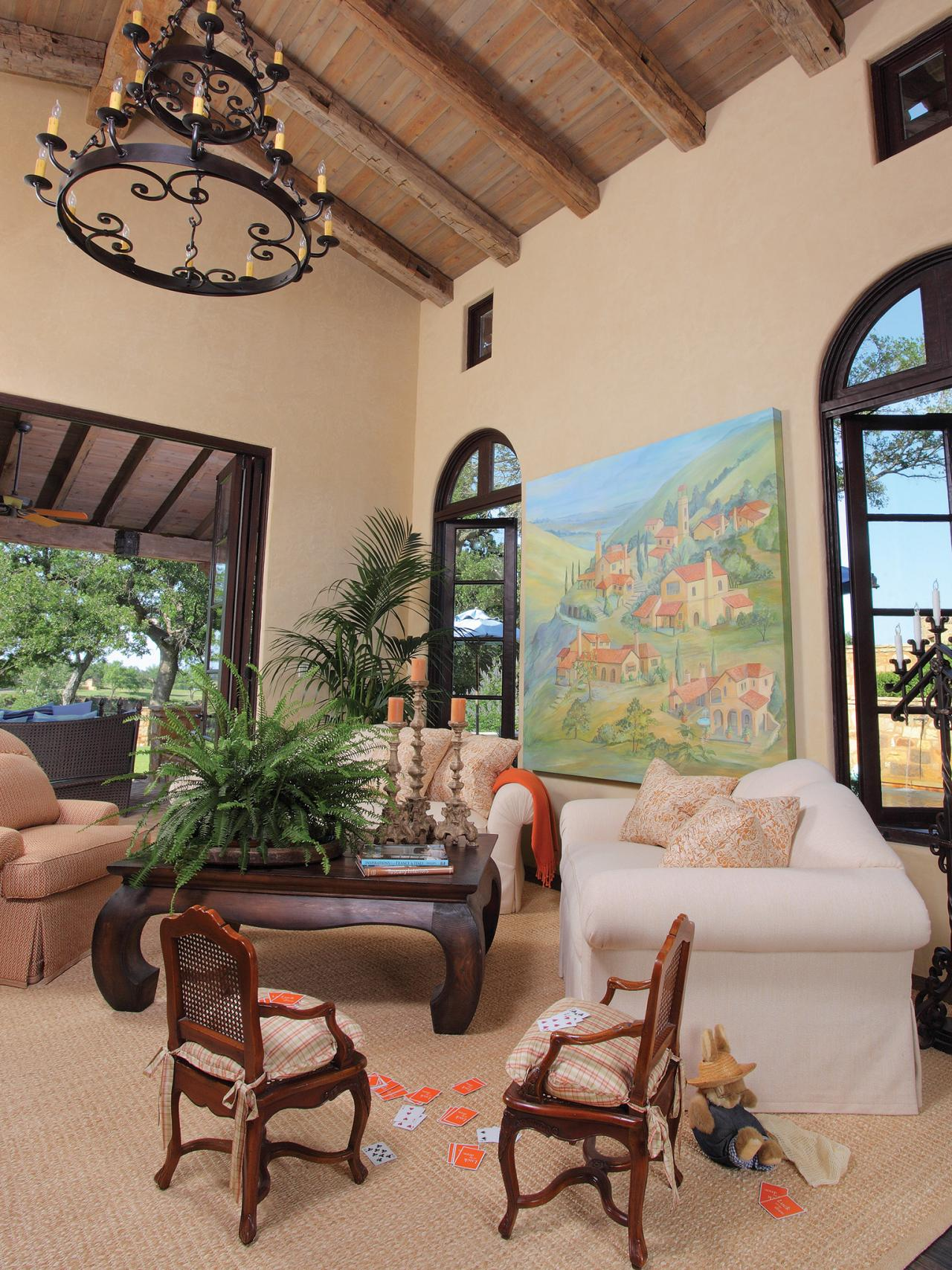 living room in spanish new style furniture design homesfeed decor with exposing beams classic chandelier white sofas wooden table chairs and pretty