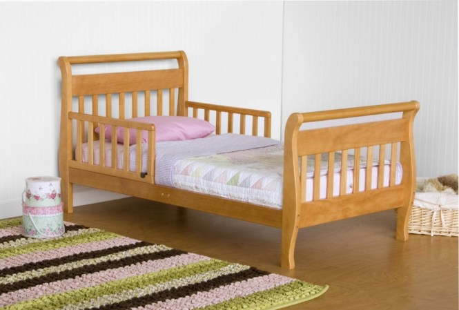 Full Size Toddler Bed With Comfy Bedding Plus Jute Rug On Wooden Floor