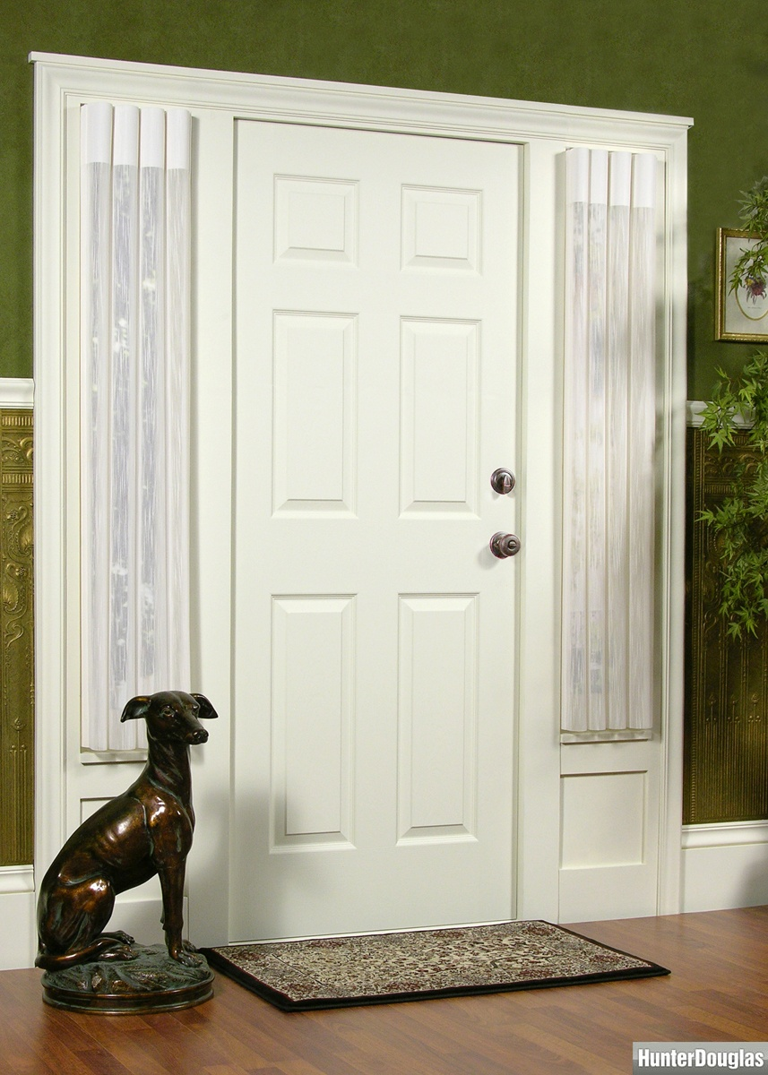 white door and white curtains of sidelight window